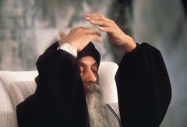 Osho guiding the evening meditation