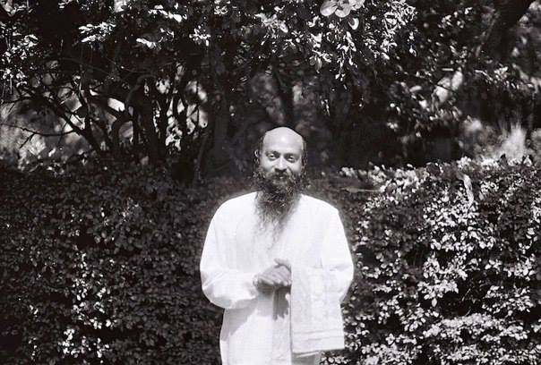 Osho in garden with towel