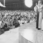 Osho greets audience in Buddha Hall