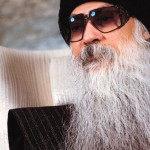 Osho wearing sunglasses