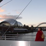 Walking over the Millennium Bridge in Newcastle
